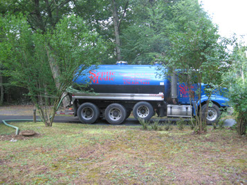 Septic Medic truck pumping a septic tank in Pike County Pennsylvania
