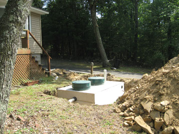 Septic tank installation occurring at a Pennsylvania residence.