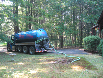 In Pike County Pennsylvania a Septic Medic truck services a residential septic system