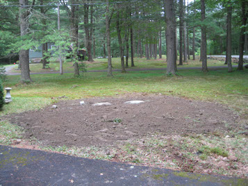 Septic system replacement underground and covered by dirt in Pike County Pennsylvania
