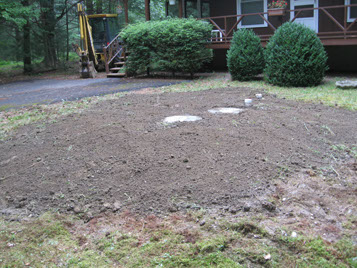 Completed septic system installation underground and covered by dirt in Pike County Pennsylvania